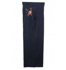 Jeans quattro tasche con fiore ricamato davanti